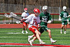 Baldwinsville Bees Braden Lynch (13) with the ball against Fayetteville-Manlius Hornets Luke Miranda (28) in Section III Boys Lacrosse action at the Pelcher-Arcaro Stadium in Baldwinsville, New York on Saturday, April 13, 2019.  Baldwinsville won 16-5.