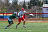 Baldwinsville Bees Braden Lynch (13) protects the ball from a Fayetteville-Manlius Hornets player in Section III Boys Lacrosse action at the Pelcher-Arcaro Stadium in Baldwinsville, New York on Saturday, April 13, 2019.  Baldwinsville won 16-5.