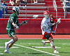 Baldwinsville Bees Michael Tangredi (26) with the ball against a Fayetteville-Manlius Hornets defender in Section III Boys Lacrosse action at the Pelcher-Arcaro Stadium in Baldwinsville, New York on Saturday, April 13, 2019.  Baldwinsville won 16-5.
