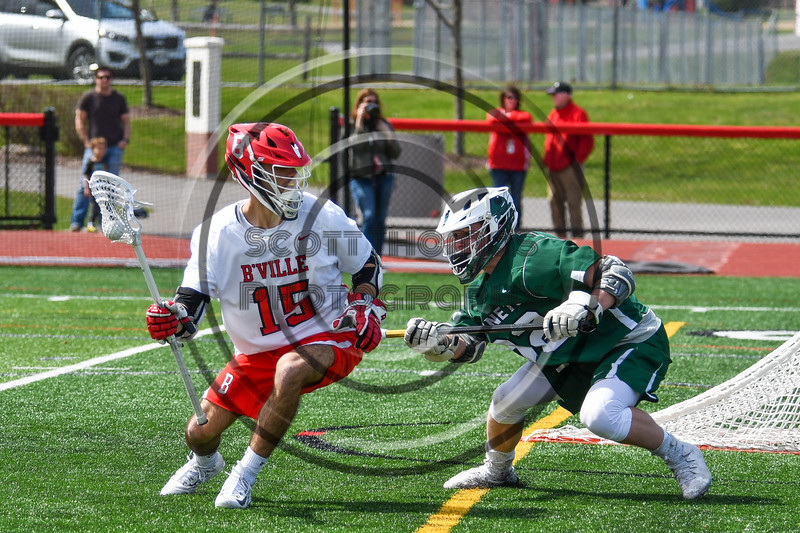 Baldwinsville Bees Austin Bolton (15) being defended by Fayetteville-Manlius Hornets Logan Wilkinson (32) in Section III Boys Lacrosse action at the Pelcher-Arcaro Stadium in Baldwinsville, New York on Saturday, April 13, 2019.  Baldwinsville won 16-5.