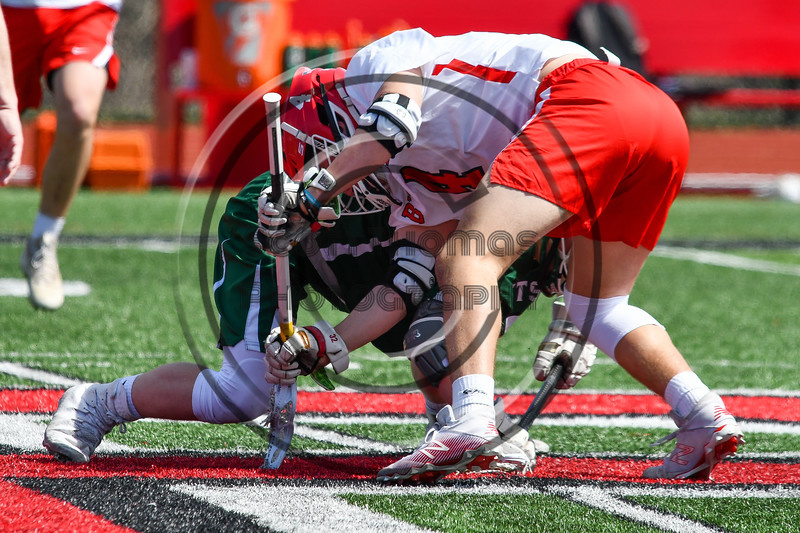 Baldwinsville Bees Jake Walsh (4) faces off against Fayetteville-Manlius Hornets Logan Wilkinson (32) in Section III Boys Lacrosse action at the Pelcher-Arcaro Stadium in Baldwinsville, New York on Saturday, April 13, 2019.  Baldwinsville won 16-5.