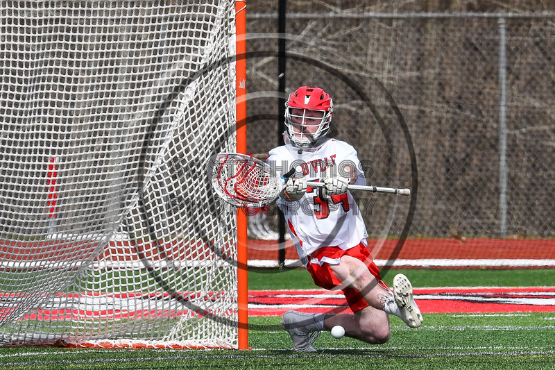 Baldwinsville Bees goalie Daniel Stehle (34) makes a save against the Fayetteville-Manlius Hornets in Section III Boys Lacrosse action at the Pelcher-Arcaro Stadium in Baldwinsville, New York on Saturday, April 13, 2019.  Baldwinsville won 16-5.
