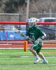 Fayetteville-Manlius Hornets Matthew Wodka (14) with the ball against the Baldwinsville Bees in Section III Boys Lacrosse action at the Pelcher-Arcaro Stadium in Baldwinsville, New York on Saturday, April 13, 2019.  Baldwinsville won 16-5.
