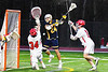 Baldwinsville Bees defenders Caleb Voorhees (17) and goalie Daniel Stehle (34) stop West Genesee Wildcats Anthony Dattellas (24) from scoring in Section III Boys Lacrosse action at the Pelcher-Arcaro Stadium in Baldwinsville, New York on Tuesday, April 23, 2019. Baldwinsville won 16-6.