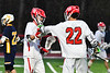Baldwinsville Bees Brendan Wilcox (22) congratulates Adam Davis (3) on his goal against the West Genesee Wildcats in Section III Boys Lacrosse action at the Pelcher-Arcaro Stadium in Baldwinsville, New York on Tuesday, April 23, 2019. Baldwinsville won 16-6.