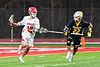 Baldwinsville Bees Spencer Wirtheim (10) being defended by West Genesee Wildcats Brad James (22) in Section III Boys Lacrosse action at the Pelcher-Arcaro Stadium in Baldwinsville, New York on Tuesday, April 23, 2019. Baldwinsville won 16-6.