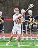 Baldwinsville Bees Spencer Wirtheim (10) passing the ball against the West Genesee Wildcats in Section III Boys Lacrosse action at the Pelcher-Arcaro Stadium in Baldwinsville, New York on Tuesday, April 23, 2019. Baldwinsville won 16-6.