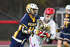 Baldwinsville Bees Braden Lynch (13) defending against West Genesee Wildcats Jack Delaney (14) in Section III Boys Lacrosse action at the Pelcher-Arcaro Stadium in Baldwinsville, New York on Tuesday, April 23, 2019. Baldwinsville won 16-6.