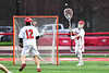 Baldwinsville Bees goalie Daniel Stehle (34) passing the ball to Connor Steria (12) against the West Genesee Wildcats in Section III Boys Lacrosse action at the Pelcher-Arcaro Stadium in Baldwinsville, New York on Tuesday, April 23, 2019. Baldwinsville won 16-6.