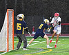 Baldwinsville Bees Quinn Peters (11) shoots and scores past West Genesee Wildcats defenders Billy Fisher (8) and goalie Luke Staudt (15) in Section III Boys Lacrosse action at the Pelcher-Arcaro Stadium in Baldwinsville, New York on Tuesday, April 23, 2019. Baldwinsville won 16-6.