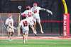 Baldwinsville Bees Braden Lynch (13) and Brendan Wilcox (22) celebrates the goal by Wilcox against the West Genesee Wildcats in Section III Boys Lacrosse action at the Pelcher-Arcaro Stadium in Baldwinsville, New York on Tuesday, April 23, 2019. Baldwinsville won 16-6.