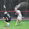 Water flies when Baldwinsville Bees Spencer Wirtheim (10) steps into a shot at the West Genesee Wildcats net in Section III Boys Lacrosse action at the Pelcher-Arcaro Stadium in Baldwinsville, New York on Tuesday, April 23, 2019. Baldwinsville won 16-6.