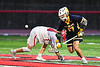 West Genesee Wildcats Cullen Kerchner (17) wins a face-off against Baldwinsville Bees Jake Walsh (4) in Section III Boys Lacrosse action at the Pelcher-Arcaro Stadium in Baldwinsville, New York on Tuesday, April 23, 2019. Baldwinsville won 16-6.