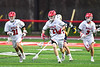 Baldwinsville Bees Cameron Sweeney (21) running with the ball against the West Genesee Wildcats in Section III Boys Lacrosse action at the Pelcher-Arcaro Stadium in Baldwinsville, New York on Tuesday, April 23, 2019. Baldwinsville won 16-6.