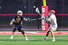 West Genesee Wildcats Brad James (22) defending against Baldwinsville Bees Noah Ravas (9) in Section III Boys Lacrosse action at the Pelcher-Arcaro Stadium in Baldwinsville, New York on Tuesday, April 23, 2019. Baldwinsville won 16-6.