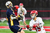 Baldwinsville Bees Austin Bolton (15) defending against West Genesee Wildcats Jack Delaney (14) in Section III Boys Lacrosse action at the Pelcher-Arcaro Stadium in Baldwinsville, New York on Tuesday, April 23, 2019. Baldwinsville won 16-6.