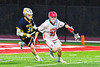 Baldwinsville Bees Carter Gates (35) with the ball against West Genesee Wildcats Alex Rosa (31) in Section III Boys Lacrosse action at the Pelcher-Arcaro Stadium in Baldwinsville, New York on Tuesday, April 23, 2019. Baldwinsville won 16-6.