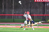 Baldwinsville Bees Cameron Sweeney (21) defending against West Genesee Wildcats Bradley Cunningham (23) in Section III Boys Lacrosse action at the Pelcher-Arcaro Stadium in Baldwinsville, New York on Tuesday, April 23, 2019. Baldwinsville won 16-6.