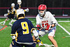 Baldwinsville Bees Braden Lynch (13) defending against West Genesee Wildcats Ryan Sheehan (9) in Section III Boys Lacrosse action at the Pelcher-Arcaro Stadium in Baldwinsville, New York on Tuesday, April 23, 2019. Baldwinsville won 16-6.