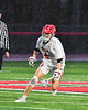 Baldwinsville Bees Jake Walsh (4) with the ball against  the West Genesee Wildcats in Section III Boys Lacrosse action at the Pelcher-Arcaro Stadium in Baldwinsville, New York on Tuesday, April 23, 2019. Baldwinsville won 16-6.