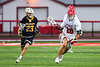 Baldwinsville Bees Michael Tangredi (26) running with the ball against West Genesee Wildcats Bradley Cunningham (23) in Section III Boys Lacrosse action at the Pelcher-Arcaro Stadium in Baldwinsville, New York on Tuesday, April 23, 2019. Baldwinsville won 16-6.
