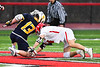 Baldwinsville Bees Jake Walsh (4) facing off against West Genesee Wildcats Max Rosa (13) in Section III Boys Lacrosse action at the Pelcher-Arcaro Stadium in Baldwinsville, New York on Tuesday, April 23, 2019. Baldwinsville won 16-6.