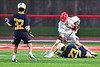 Baldwinsville Bees Cameron Sweeney (21) takes down and knocks the ball away from West Genesee Wildcats Bradley Cunningham (23) in Section III Boys Lacrosse action at the Pelcher-Arcaro Stadium in Baldwinsville, New York on Tuesday, April 23, 2019. Baldwinsville won 16-6.
