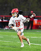 Baldwinsville Bees Garrett Petrelli (19) running with the ball against the West Genesee Wildcats in Section III Boys Lacrosse action at the Pelcher-Arcaro Stadium in Baldwinsville, New York on Tuesday, April 23, 2019. Baldwinsville won 16-6.