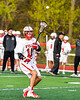 Baldwinsville Bees Quinn Peters (11) passing the ball against the Corcoran Cougars in Section III Boys Lacrosse action at the Pelcher-Arcaro Stadium in Baldwinsville, New York on Tuesday, April 30, 2019. Baldwinsville won 20-6.