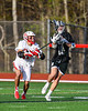 Baldwinsville Bees Quinn Peters (11) checking Corcoran Cougars Connor Leonard (15) in Section III Boys Lacrosse action at the Pelcher-Arcaro Stadium in Baldwinsville, New York on Tuesday, April 30, 2019. Baldwinsville won 20-6.