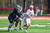 Baldwinsville Bees Adam Davis (3) with the ball against Corcoran Cougars defenders in Section III Boys Lacrosse action at the Pelcher-Arcaro Stadium in Baldwinsville, New York on Tuesday, April 30, 2019. Baldwinsville won 20-6.