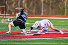 Corcoran Cougars Ryan Eccles (23) wins a face-off against Baldwinsville Bees Jake Walsh (4) in Section III Boys Lacrosse action at the Pelcher-Arcaro Stadium in Baldwinsville, New York on Tuesday, April 30, 2019. Baldwinsville won 20-6.
