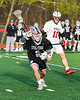 Corcoran Cougars Matt Boyle (8) with the ball against the Baldwinsville Bees in Section III Boys Lacrosse action at the Pelcher-Arcaro Stadium in Baldwinsville, New York on Tuesday, April 30, 2019. Baldwinsville won 20-6.
