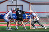 Corcoran Cougars Derrick Noreault (5) and Baldwinsville Bees defenders Caleb Voorhees (17) and goalie Daniel Stehle (34) battle over a ground ball in Section III Boys Lacrosse action at the Pelcher-Arcaro Stadium in Baldwinsville, New York on Tuesday, April 30, 2019. Baldwinsville won 20-6.