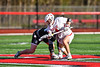 Baldwinsville Bees Jake Walsh (4) wins a face-off against Corcoran Cougars Ryan Eccles (23) in Section III Boys Lacrosse action at the Pelcher-Arcaro Stadium in Baldwinsville, New York on Tuesday, April 30, 2019. Baldwinsville won 20-6.