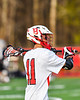 Baldwinsville Bees Quinn Peters (11) looking to make a pass against the Corcoran Cougars in Section III Boys Lacrosse action at the Pelcher-Arcaro Stadium in Baldwinsville, New York on Tuesday, April 30, 2019. Baldwinsville won 20-6.