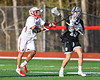 Baldwinsville Bees Quinn Peters (11) knocks the ball from Corcoran Cougars Connor Leonard (15) in Section III Boys Lacrosse action at the Pelcher-Arcaro Stadium in Baldwinsville, New York on Tuesday, April 30, 2019. Baldwinsville won 20-6.