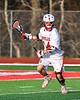 Baldwinsville Bees Matthew Wodka (14) with the ball against the Corcoran Cougars in Section III Boys Lacrosse action at the Pelcher-Arcaro Stadium in Baldwinsville, New York on Tuesday, April 30, 2019. Baldwinsville won 20-6.