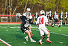 Corcoran Cougars Matt Boyle (8) comes up with a ground ball against the Baldwinsville Bees in Section III Boys Lacrosse action at the Pelcher-Arcaro Stadium in Baldwinsville, New York on Tuesday, April 30, 2019. Baldwinsville won 20-6.