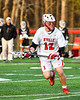 Baldwinsville Bees Connor Steria (12) running with the ball against the Corcoran Cougars in Section III Boys Lacrosse action at the Pelcher-Arcaro Stadium in Baldwinsville, New York on Tuesday, April 30, 2019. Baldwinsville won 20-6.
