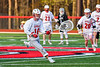 Baldwinsville Bees goalie Andrew Davis (18) running with the ball against the Corcoran Cougars in Section III Boys Lacrosse action at the Pelcher-Arcaro Stadium in Baldwinsville, New York on Tuesday, April 30, 2019. Baldwinsville won 20-6.