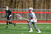 Baldwinsville Bees goalie Daniel Stehle (34) running with the ball against the Corcoran Cougars in Section III Boys Lacrosse action at the Pelcher-Arcaro Stadium in Baldwinsville, New York on Tuesday, April 30, 2019. Baldwinsville won 20-6.