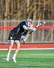 Corcoran Cougars Connor Leonard (15) passing the ball against the Baldwinsville Bees in Section III Boys Lacrosse action at the Pelcher-Arcaro Stadium in Baldwinsville, New York on Tuesday, April 30, 2019. Baldwinsville won 20-6.