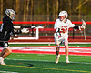 Baldwinsville Bees Casey Scott (20) with the ball against the Corcoran Cougars in Section III Boys Lacrosse action at the Pelcher-Arcaro Stadium in Baldwinsville, New York on Tuesday, April 30, 2019. Baldwinsville won 20-6.