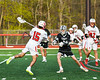 Baldwinsville Bees Austin Bolton (15) winding up for a shot at the Corcoran Cougars net in Section III Boys Lacrosse action at the Pelcher-Arcaro Stadium in Baldwinsville, New York on Tuesday, April 30, 2019. Baldwinsville won 20-6.