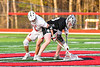 Baldwinsville Bees Jake Walsh (4) facing off with  Corcoran Cougars Ryan Eccles (23) in Section III Boys Lacrosse action at the Pelcher-Arcaro Stadium in Baldwinsville, New York on Tuesday, April 30, 2019. Baldwinsville won 20-6.