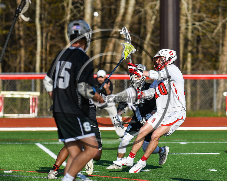 Baldwinsville Bees Spencer Wirtheim (10) passing the ball against the Corcoran Cougars in Section III Boys Lacrosse action at the Pelcher-Arcaro Stadium in Baldwinsville, New York on Tuesday, April 30, 2019. Baldwinsville won 20-6.