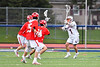 Liverpool Warriors Ryan McGowan (1) passing the ball against a trio of Baldwinsville Bees defenders in Section III Boys Lacrosse action at Liverpool High School Stadium in Liverpool, New York on Thursday, May 2, 2019.  Baldwinsville won 12-8.