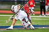 Baldwinsville Bees Cameron Slink (25) facing off against Liverpool Warriors Jake Piseno (21) to start a Section III Boys Lacrosse game at Liverpool High School Stadium in Liverpool, New York on Thursday, May 2, 2019.  Baldwinsville won 12-8.