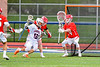 Baldwinsville Bees defender checks Liverpool Warriors Brendan Mancuso (13) drivng to the net in Section III Boys Lacrosse action at Liverpool High School Stadium in Liverpool, New York on Thursday, May 2, 2019.  Baldwinsville won 12-8.